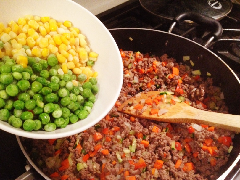 Adding some corn and peas