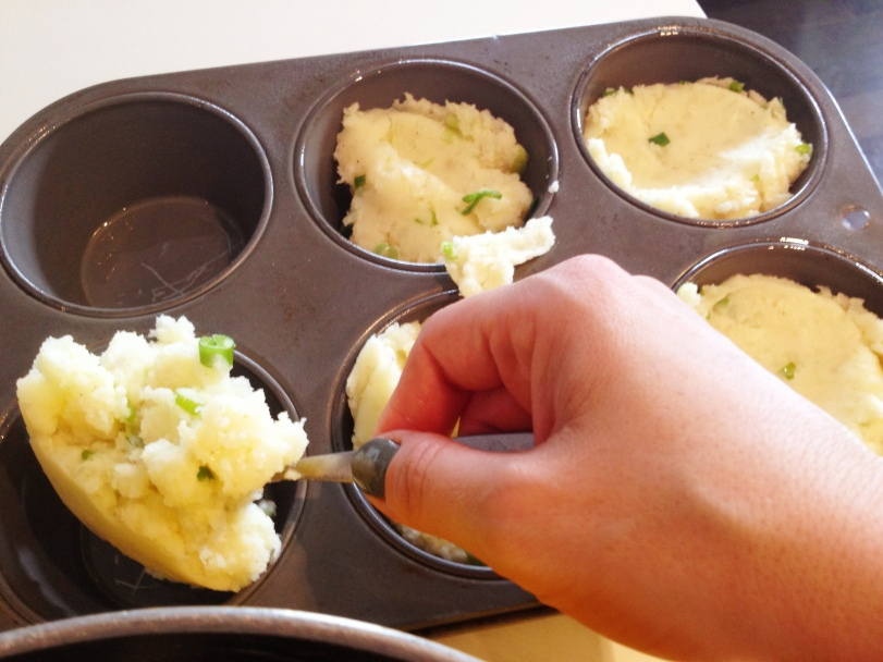 fill up your muffin tin with the potato mixture