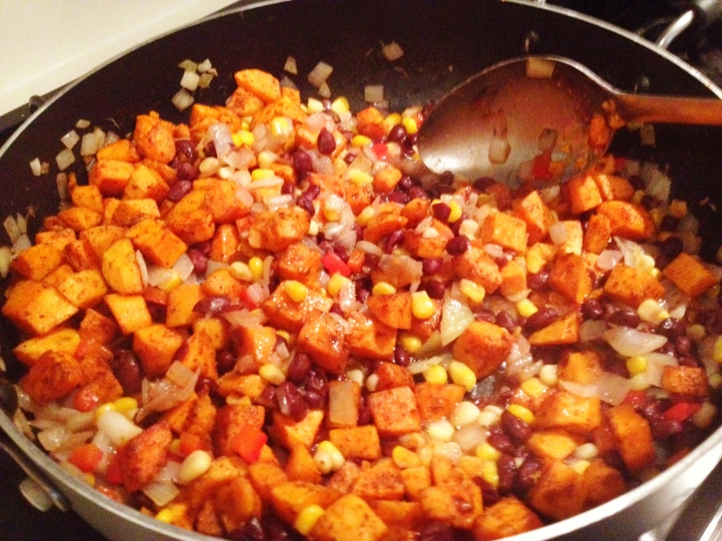 Add the sweet potatoes to the skillet and mix together until the mixture gets coated with the honey and lime.