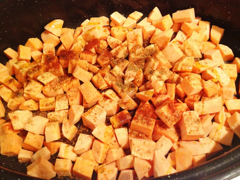 Add your spices to the chopped Sweet Potatoes